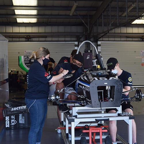 The team working on the car under COVID restrictions